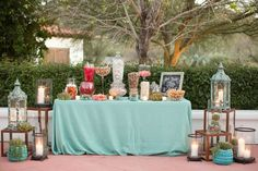 dessert table with lanterns and candles - photo by Amy & Jordan Photography