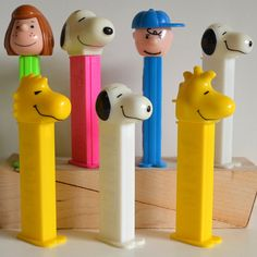 Pez featuring the Charlie Brown gang. I am the Pink Snoopy in the 2nd row. Yes, that's me!  Next to you, Charlie Brown.  You are wearing BLUE outfit.  You must like me. From Snoopy the Dog.