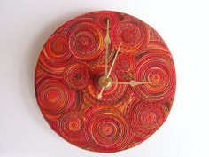 Color Trend 2013 Poppy Red - Recycled Wall Clock, upcycled CD, polymer clay, red brown gold. $39.00, via Etsy.