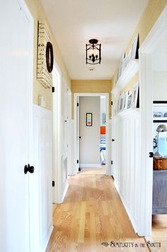 This before and after is fabulous...you have to see it!  DIY Board and batten hallway with gallery shelves.