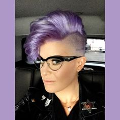 Kelly Osbourne's glasses are awesome. Of course, I wouldn't buy Prada... but something similar.