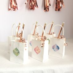 Here is an example of how they look on these mini bags with gifts such as sweets and a Rose Gold pencils. Eid Favours, Favors, Eid Mubarek, Eid Stickers, Eid Crafts, Hand Embroidery Art, Embroidery On Clothes, Quatrefoil, Place Card Holders