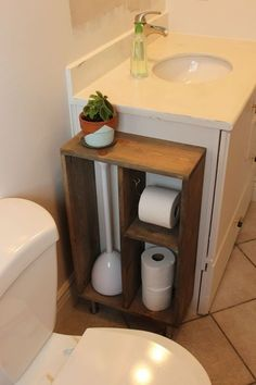 This is a tutorial for building your own custom storage shelving to attach to the side of your bathroom vanity. The idea is to contain toilet paper and oth #UpdatingBathroomFurniture