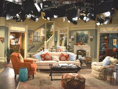 Maralee Zediker- set decorator for Hot in Cleveland. Amazing vintage style. The stainglass above the doors, wall colors, molding, fireplace tile, etc. LOVE