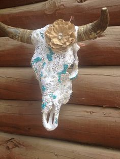 Created for a wedding ! Custom lace and AB Swarovski cow skull . Made by jack it up designs .