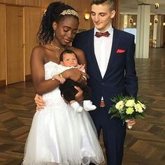 Beautiful interracial couple with their baby on their wedding day #love #wmbw #bwwm #swirl #wedding #lovingday #relationshipgoals