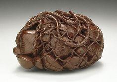 Netsuke ~ String Bag of Clams, late 19th century ~ Wood, 1-1/2 x 1-1/4 x 1 inch
