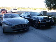 My 2013 Mercedes C350 w/Sport Plus package beside my 2011 Aston Martin v8 Vantage Roadster.  $200k+ of beautiful cars.