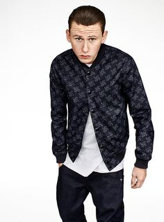 James wears the Printed Fallden Bomber Jacket and Arc 3D Slim Tapered Jeans. #rawfortheoceans