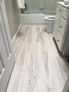 Update The Look Of Your Bat Kitchen Or Bathroom With This Trafficmaster Allure Alpine Elm Luxury Vinyl Plank Flooring Durable Is