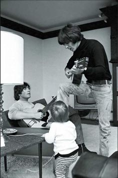 John and George with little Julian Lennon at John's house Kenwood, Surrey -- photo by Henry Grossman 1965
