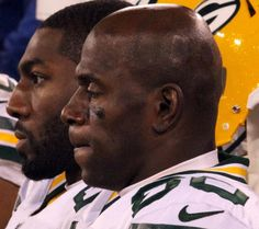 Packers wide receivers Donald Driver (foreground) and Greg Jennings sit on the bench near the end of Saturday's game. Go Packers, Green Bay Packers, Greg Jennings, Donald Driver, Wide Receiver, Big Sean, World Of Sports, Bench, Fan