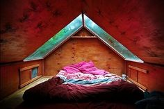 attic skylight.. for stargazing, thunderstorms, and lookin' for shapes in the clouds :)