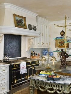 Beautiful crown molding and gold accents. A bit too cluttered for my taste but it would look perfect without the paintings, and figurines on counters.