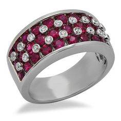 This marvelous design features over 1 carat of beautiful round cut rubies and brilliant round cut diamonds separating them. The color of the diamonds are H/I and clarity is SI2/SI3.Different ring sizes may be available. Please inquire for details. $664.00