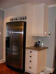 wine cubbies above fridge, extended depth cabinet above