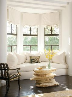 I like this photo for both its window seat and its coffee table, made of rustic stone or stacked pieces of selenite because they are unusual and different. The natural materials give an earthy, sensual feel to the furnishings and it's fun to juxtapose these organic elements with more refined, elegant antiques. Richard Hallberg - Veranda.com
