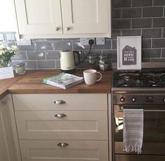 Cream shaker kitchen with grey metro tiles Cream s Cream Kitchen Units, Cream Shaker Kitchen, Backsplash For White Cabinets, Kitchen Cabinets In Bathroom, Kitchen Furniture, New Kitchen, Kitchen Decor, Cream And Grey Kitchen, Ikea Furniture