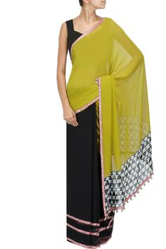 Olive green and black printed pallu sari with olive raw silk blouse piece BY MANISH MALHOTRA Shop the designer now at: www.perniaspopups... #perniaspopupshop #manishmalhotra #newcollection #softhues #stunning #fashion #amazing #style #campaign #fabulous #musthave #summerwedding #happyshopping