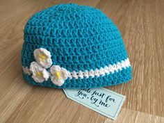 Crocheted Baby Love Me, Love Me Not... Hat, Ideal for Baby Shower Gift!  This little hat is absolutely sweet. Made in a soft blend of cotton and