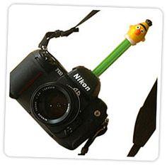pez dispensor smile hack.. put pez dispensor on top of camera to get inquisitive closeup shots of toddlers
