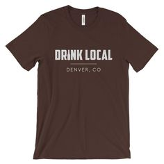 Denver, CO Drink Local Unisex T-shirt (Dark)  A Kool shirt for the Colorado Kool-Aid lover. This super-soft, baby-knit t-shirt looks great on both men and women – it fits like a well-loved favorite. Made from 100% cotton, except for heather colors, which contain polyester.  • 100% ring-spun cotton (heather colors contain polyester) • Baby-knit jersey  • Shoulder-to-shoulder taping  • Cover stitched and hemmed sleeves  • Side-seamed
