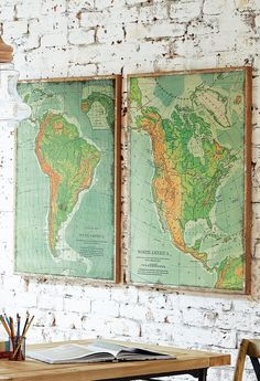 """Celebrate North and South America in a big and beautiful way, with the two-piece """"The Americas"""" artwork on your wall. Each oversized piece – nearly three feet wide and almost four feet tall – is a wonderful topographical representation of each of the American continents, warmly reminiscent of a classic schoolroom map…"""