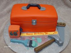 Chocolate cake with chocolate raspberry filling covered in BC and fondant. All tools are made out of fondant, tape measure is rice krispy tr...
