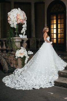 Speranza Couture tulle wedding dress skirt and train embroidered with flowers and butterflies.