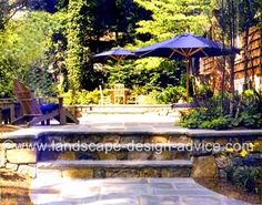 Blueston patio with two levels. This design includes a seat wall and beautiful stone steps.