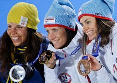 Women's cross country skiing skiathlon silver medalist Charlotte Kalla, left, of Sweden, gold medalist Marit Bboergen, center, of Norway and Heidi Weng, of Norway show off their medals. (David J. Phillip/AP)