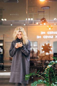 Buy Blonde girl standing with smartphone by simbiothy on PhotoDune. Portrait of pretty blonde girl standing next to window with smartphone Pretty Blonde Girls, Attractive Background, Office People, Business Women, Business Logos, Girl Standing, Photoshop Photography, White Women