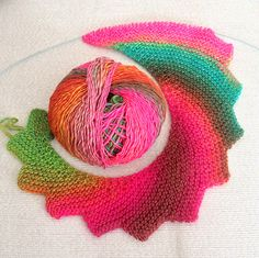 """drachenschwanz Cast on 3 sts.  Row 1 - k, kfb, kfb (all subsequent """"Row 1s"""" - k, kfb, k, kfb, k to end)  Rows 2, 4, 6, 8 - knit across  Rows 3, 5, 7, 9 - k, kfb, k, kfb, k to end  Row 10 - cast off 6 sts, knit to end  Repeat rows 1-10 three more times (40 rows total), then continue in pattern except cast off 7 sts every 10th row rather than 6.  Knit as long as you or your wool want."""