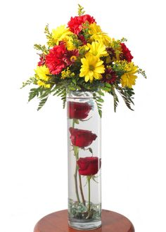 Fantastic 3 submerged Roses with an arrangement created in a variety of different flowers for any wedding or party centrepiece only £25.00 with no set up or delivery changes. Min Order 5 and delivered within 50 miles radius of LE3