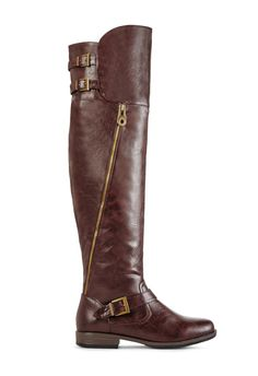 Comfortable and supple, what more could you want? Caitlin by JustFab is an over-the-knee boot featuring double top buckles, non-functional outer zip detail, and a sturdy base.