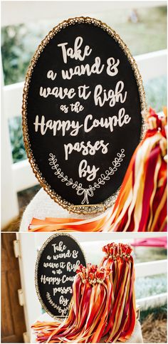 "Fun wedding reception ideas to greet the newlyweds, ""take a wand and wave it high as the happy couple walks by"" sign, brightly colored orange and red ribbons // Katie Norrid Photography"