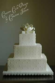 Simple and elegant....gorgeous white. Creative Cake Designs (Christina)