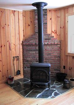 Stone hearth and brick wall behind wood stove. I like the stone hearth here! Wood Stove Wall, Corner Wood Stove, Wood Stove Surround, Wood Stove Hearth, Hearth Stone, Wood Burner, Brick Hearth, Stove Fireplace, Fireplace Design