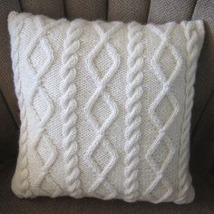 This pillow cover pattern is knit as one piece using a worsted or aran weight yarn. 3 buttonholes are worked in the ribbing to secure the envelope closure. Diamonds and Cable Pillow Cover by Jennifer Wilby on Ravelry Knitted Cushion Covers, Knitted Cushions, Knitted Throws, Diy Pillows, Decorative Pillows, Throw Pillows, Crochet Pillow, Knit Or Crochet, Knitting Projects
