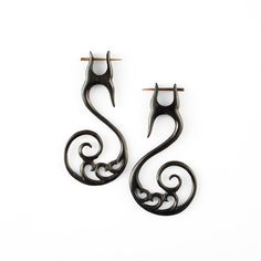 "Fake Gauge Earrings - Tribal Horn Earrings Fake Piercing - Buffalo Horn ""Swinging Hearts"" earrings. $22.00, via Etsy."