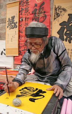 Asian people Chinese Calligraphy photo in Vietnam Laos, Moleskine, Beautiful Vietnam, Chinese Calligraphy, Calligraphy Ink, Asian Elephant, Indochine, China Art, Vietnam Travel