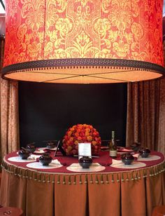 Featured at the 2013 Architectural Digest Home Show, Fabricut's stunning table rejuvenates the dining experience with European fabrics and an Asian flair.