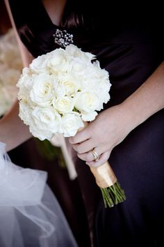 Black and White Wedding - Bridesmaids and groomsmen wear black dresses and suits with white flowers, and the bride and groom both wear white.  Absolutely gorgeous!