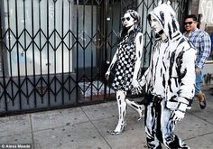 Alexa Meade - The painted couple pictured walking down the street as they are transformed into true works of art