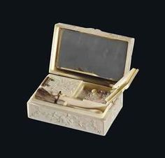 A CARVED IVORY AND GOLD MAKE-UP BOX, FRENCH, 18TH CENTURY