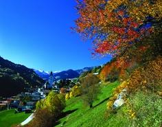 Switzerland. Autumnal Greetings.    Colourful autumn in Sumvitg / Somvix (1044 m) in the Vorderrhein Valley, Canton Graubuenden    Copyright by Switzerland Tourism By-line: swiss-image.ch/Christof Sonderegger