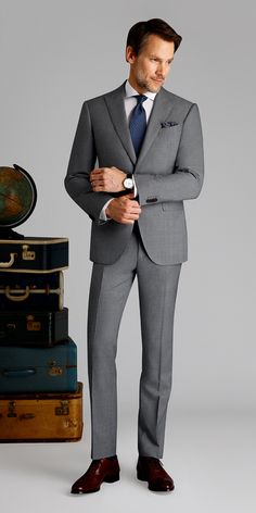 Get this light gray sharkskin suit made with Vitale Barberis Canonico, Super wool made to your exact measurements and customized just the way you want it. Grey Suit Blue Tie, Light Grey Suit Men, Khaki Suits, Brown Suits, Mens Fashion Suits, Mens Suits, Men's Fashion, David Beckham Suit, Fit Men Bodies
