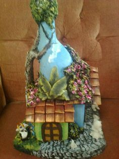 This Pin was discovered by Soa Bead Bottle, Wine Bottle Art, Diy Bottle, Recycled Glass Bottles, Glass Bottle Crafts, Painted Wine Bottles, Plastic Bottle House, Clay Fairy House, Paper Bag Crafts