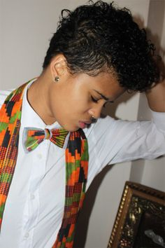 This person sewed her own kente bowtie and scarf.