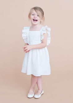 """The """"Brinn"""". 100% cotton, fully lined, ruffle pinafore.  Gentille Alouette original.  Available for limited purchase Spring/Summer 2015"""